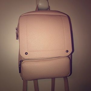 Light pink backpack purse